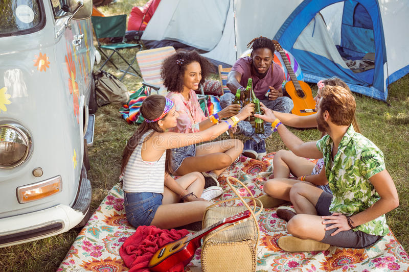 Hipsters having fun in their campsite. At a music festival stock photos