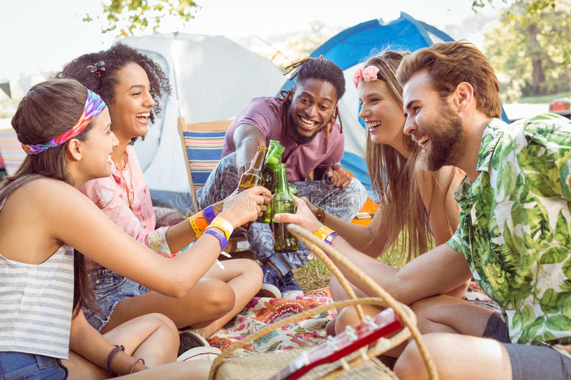 Hipsters having fun in their campsite. At a music festival royalty free stock images