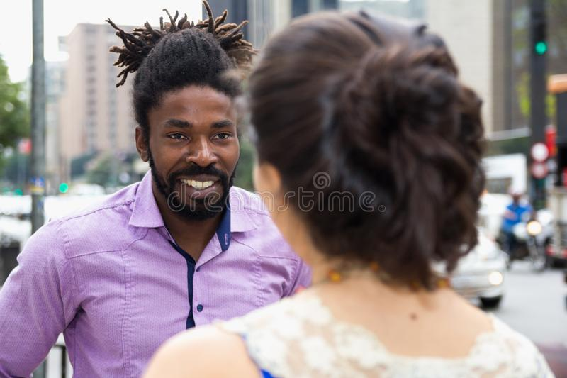 Hipsters man talking to woman in the streets royalty free stock photo