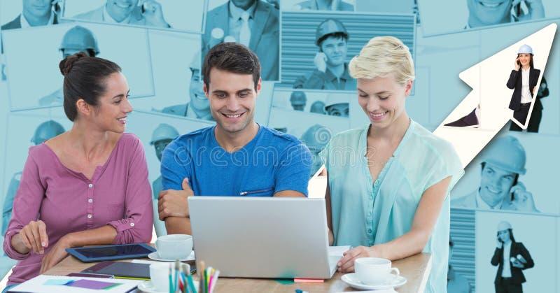 Hipsters som använder bärbara datorn på skrivbordet mot graf royaltyfri foto