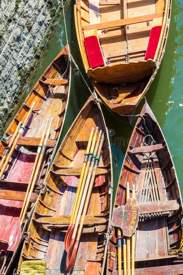 Hire boats on a river. Photos shows hire boats on a Thames river in Richmond London, which is popular with tourists and visitors royalty free stock image