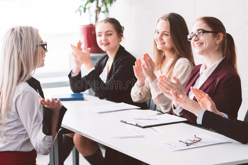 Hired female business company women support clap. Hired. Female oriented company. Business for women. Support and empowerment. HR clapping at successful royalty free stock photos