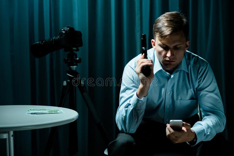 Hired killer with pistol. Waiting for a ransom stock photos