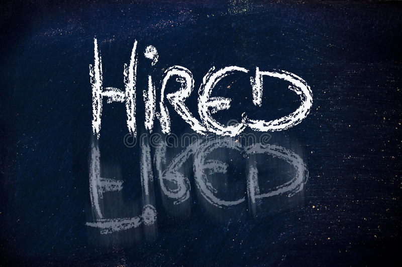 Hired vs. fired message on chalkboard royalty free illustration