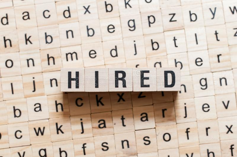 Hired word concept. On cubes royalty free stock photo