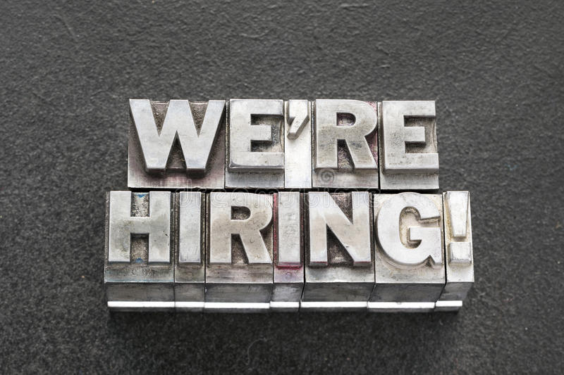 We are hiring bl. We are hiring exclamation made from vintage metallic letterpress blocks on dark background stock photography