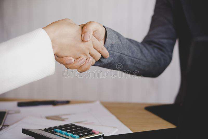 Business woman hand shake agree and ready to sign a contract stock image