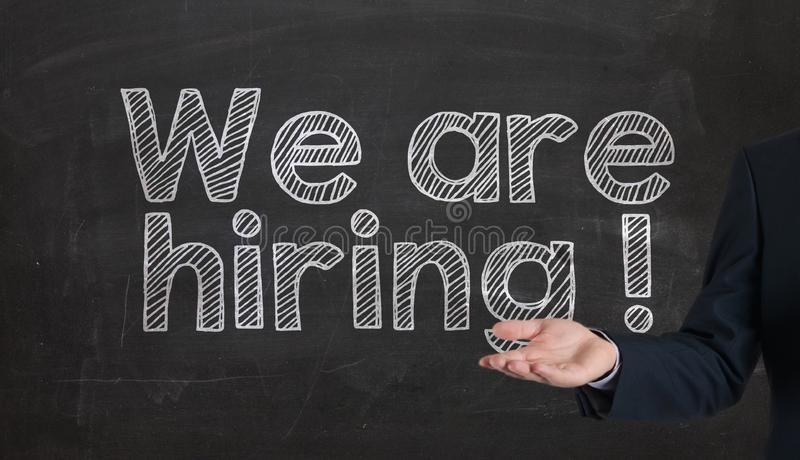 Hiring sign blackboard. we are hiring! written on black chalkb royalty free stock photography
