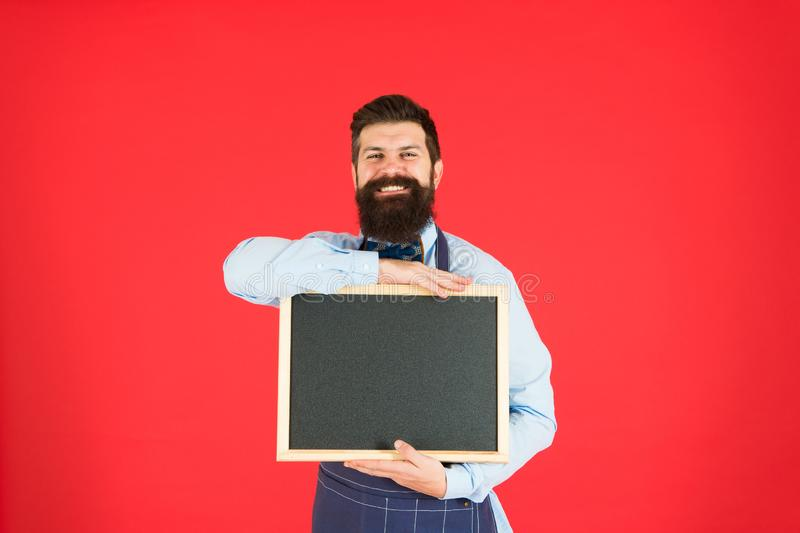 Hiring staff. Hipster bartender show blackboard copy space. Hipster restaurant staff. Hipster informing you. Man bearded stock photography