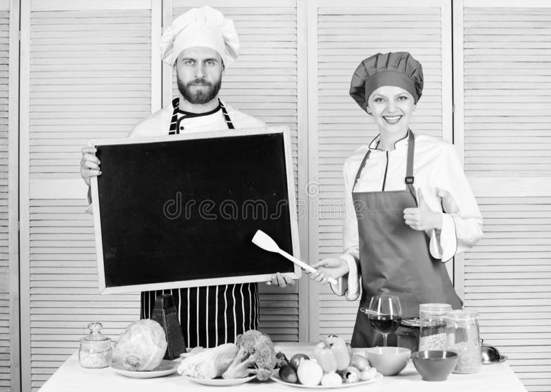 Hiring staff. Woman and man chef hold blackboard copy space. Job position. Cooking delicious meal recipe. Cooking menu stock photos