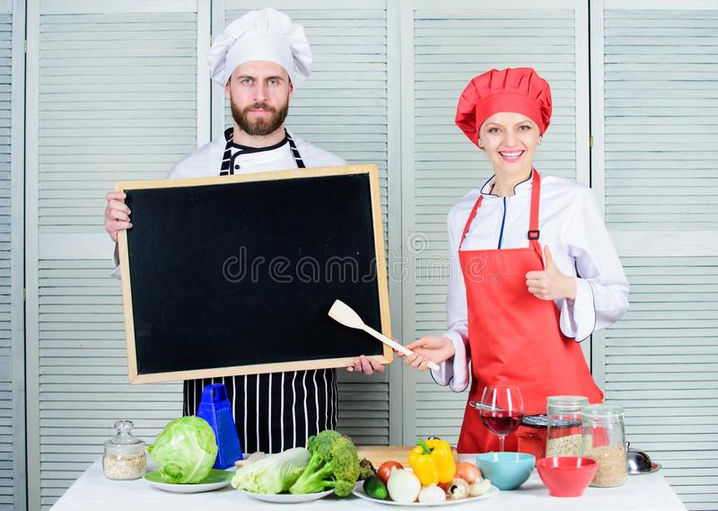 Hiring staff. Woman and man chef hold blackboard copy space. Job position. Cooking delicious meal recipe. Cooking menu stock image