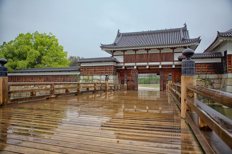 Hiroshima castle gate. With wooden bridge over water channel royalty free stock photo
