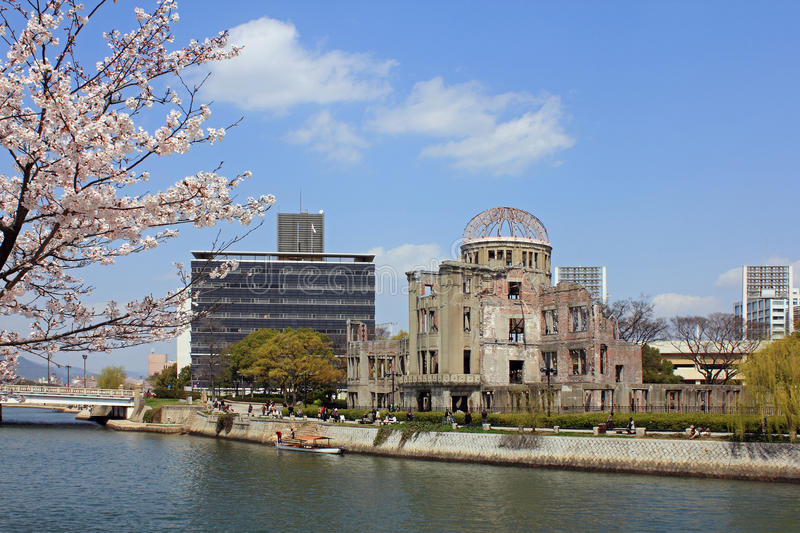 Hiroshima A-Dome with Sakura. The atomic bomb dome in Hiroshima taken in spring with sakura (cherry blossom) as foreground stock images