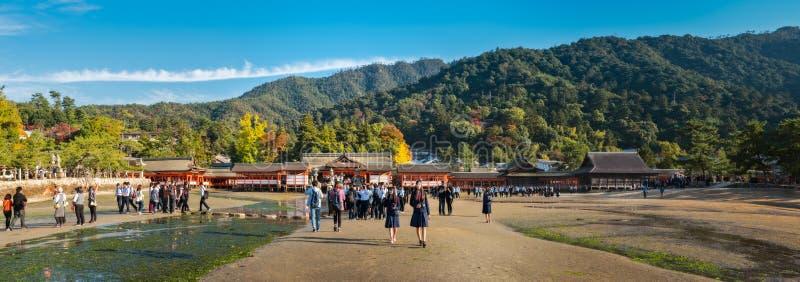 Itsukushima Shrine panorama on Miyajima Island at low tide in autumn. Hiroshima, Japan - November 7, 2018: Tourists visiting Itsukushima Shrine on Miyajima stock photography