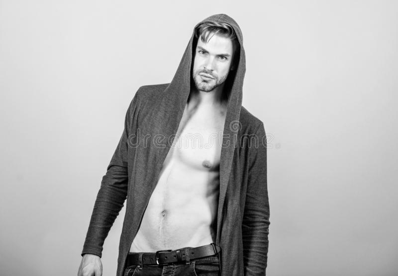 His body is perfect. fitness dieting for good shape. Guy fashion model. man in trendy hooded jacket. sexy macho in denim royalty free stock images