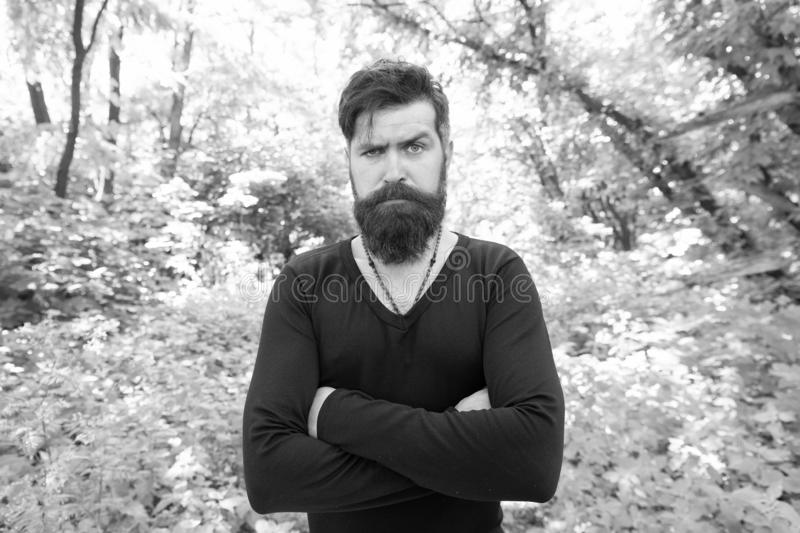 His brutal style. Brutal hipster wearing casual style outdoor. Bearded man with brutal look keeping arms crossed. Brutal stock photography