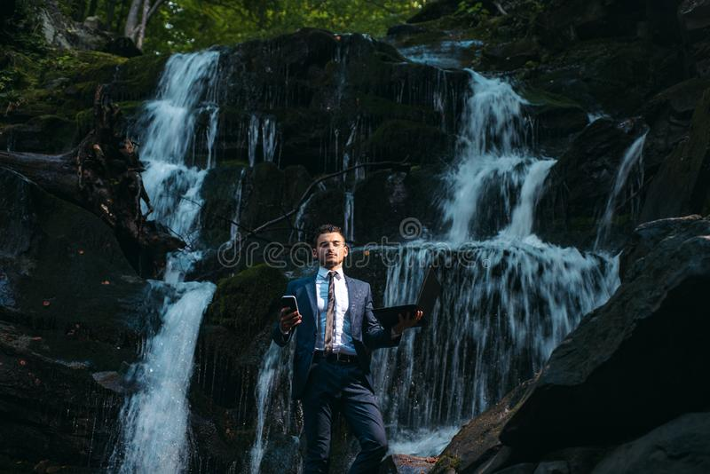 His freelance business allowing him to travel. Successful businessman doing business online. Handsome man using new stock photo