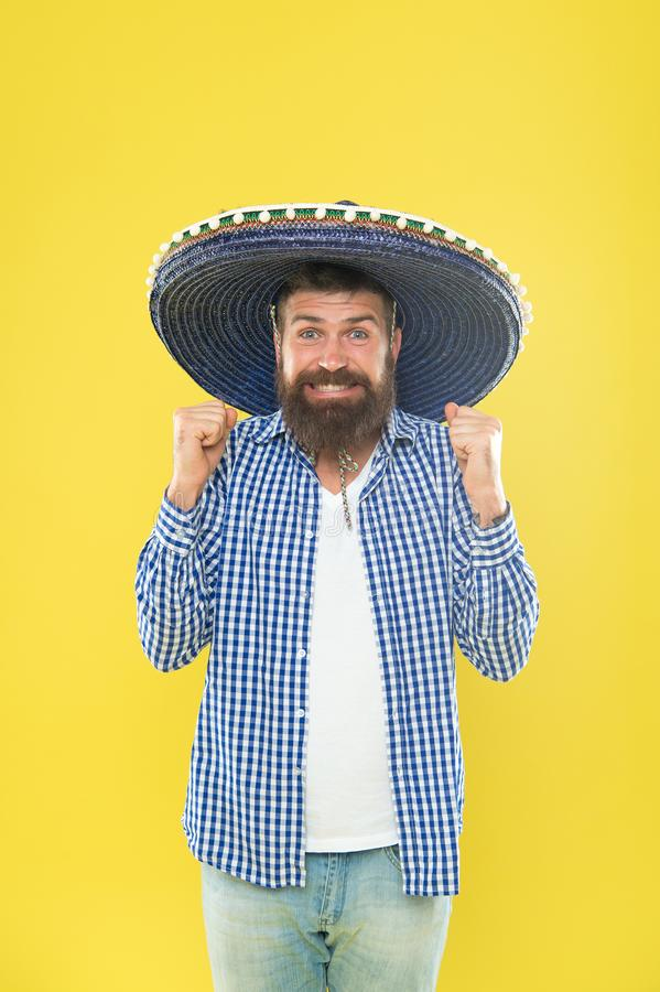 His giant sombrero is perfect. Traditional fashion accessory for costume party. Mexican man wearing sombrero. Bearded. Man in mexican hat. Hipster in wide brim stock images