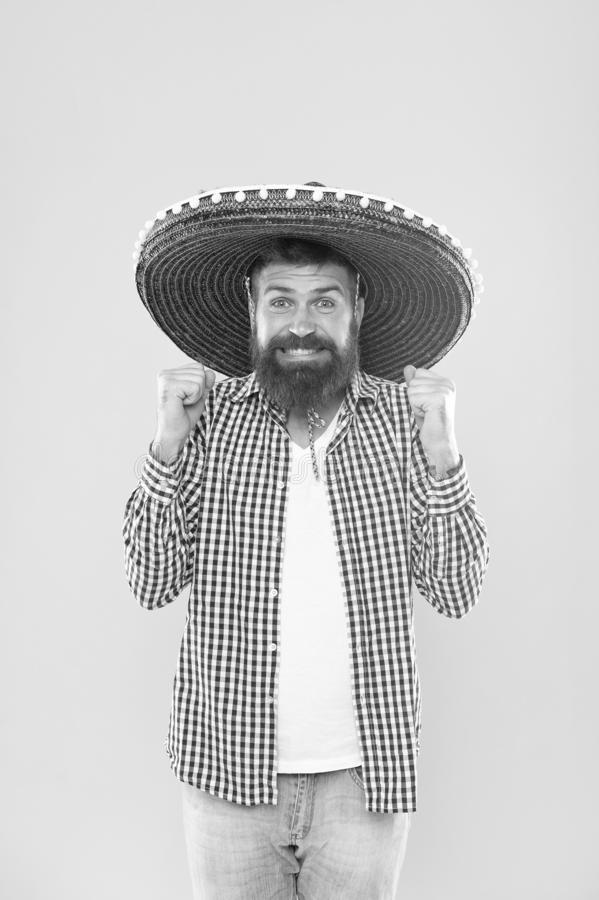 His giant sombrero is perfect. Traditional fashion accessory for costume party. Mexican man wearing sombrero. Bearded. Man in mexican hat. Hipster in wide brim royalty free stock image