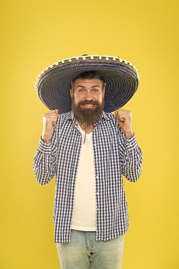 His giant sombrero is perfect. Traditional fashion accessory for costume party. Mexican man wearing sombrero. Bearded. Man in mexican hat. Hipster in wide brim stock image