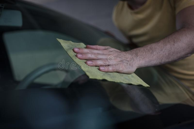 His hand has good movements to shine the car. Man cleaning car stock photography