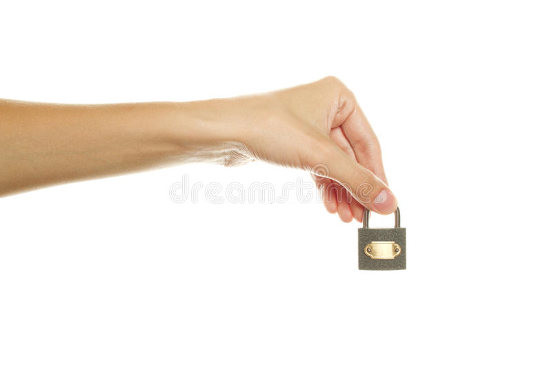 In his hand lock. Close-up of female hand holding the lock. Isolated on white background royalty free stock photos