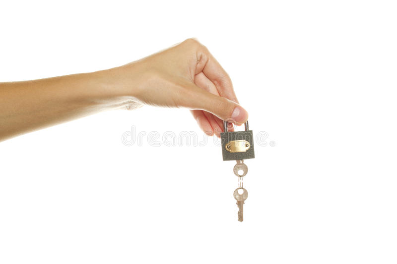 In his hand lock with keys. Close-up of female hand holding the lock with keys. Isolated on white background stock photos