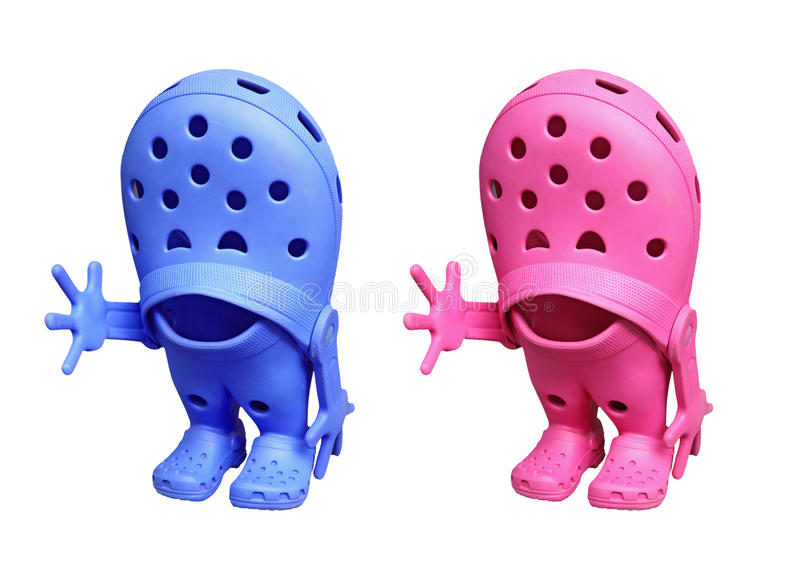 His and hers croc shoes stock photography