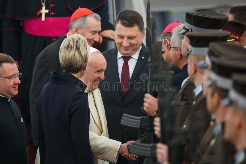 His Holiness Pope Francis and Raimonds Vejonis, President of Latvia. 24.09.2018. RIGA, LATVIA. His Holiness Pope Francis arriving at Riga International Airport stock image