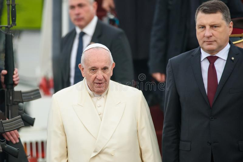 His Holiness Pope Francis and Raimonds Vejonis, President of Latvia. 24.09.2018. RIGA, LATVIA. His Holiness Pope Francis arriving at Riga International Airport stock photography