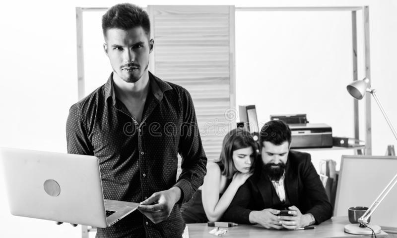 His mobile work companion. Young handsome employee and coworkers working in mobile workstation. Mobile workers stock photos