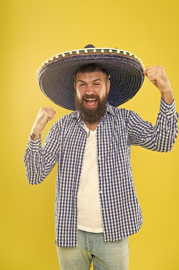 His passion is to party. Mexican man wearing sombrero. Hipster in wide brim hat. Bearded man in mexican hat. Traditional royalty free stock image