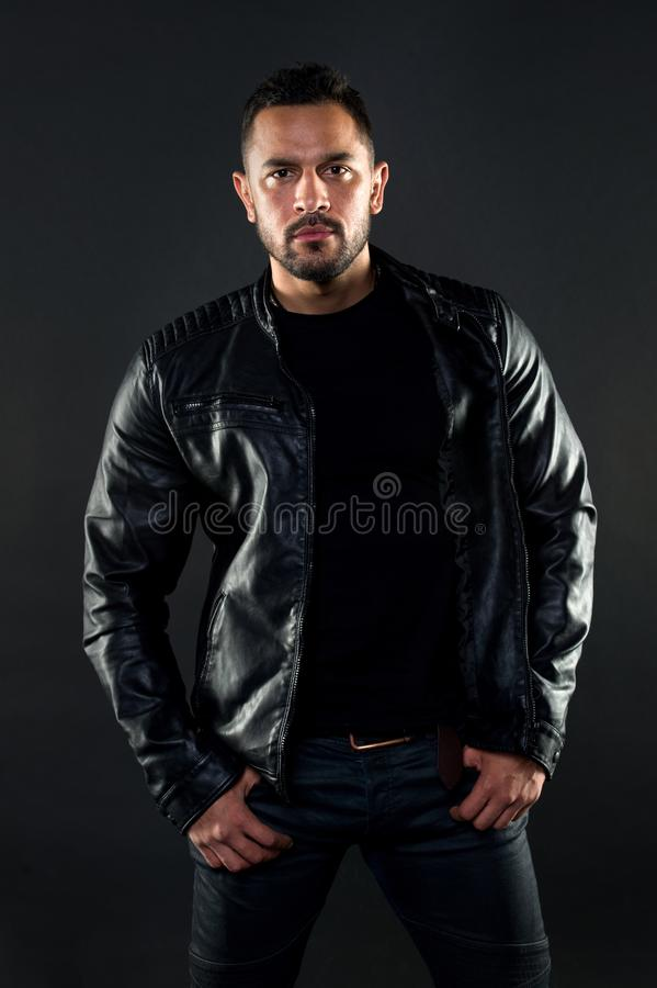 His style. Hispanic man with fashionable style. Bearded man in the fashion. Fashion model wear clothing in macho style. Brutal and muscle. Muscle erotism and royalty free stock images