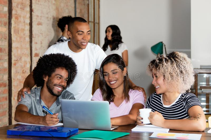 Hispanic and african american business team of young people. At modern office of start up enterprise royalty free stock photo