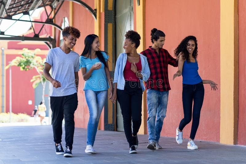 Hispanic and african american hipster young adults in city. Hispanic and african american hipster young adults outdoor in city in summer stock photography