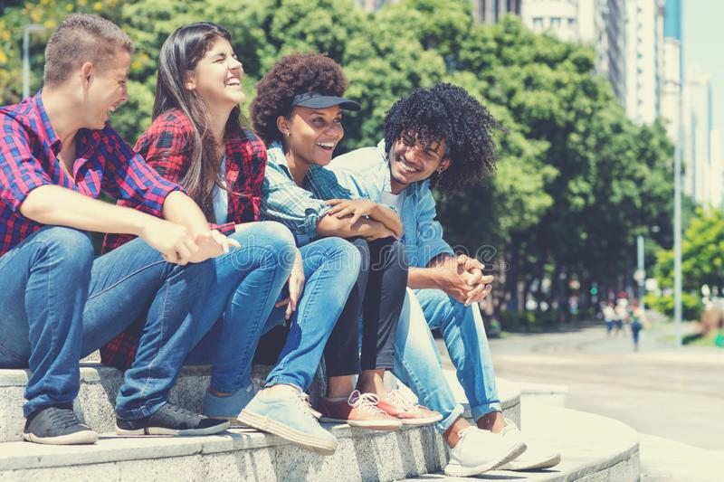 Hispanic and african american hipster young adults in the city. In the summer stock photo