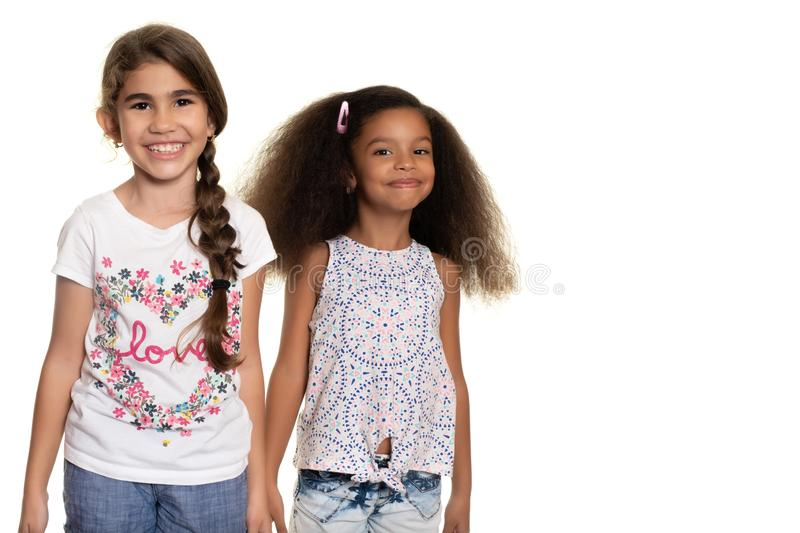 Hispanic and african american small girls on a white background. Hispanic and african american small girls - Isolated on white stock photos