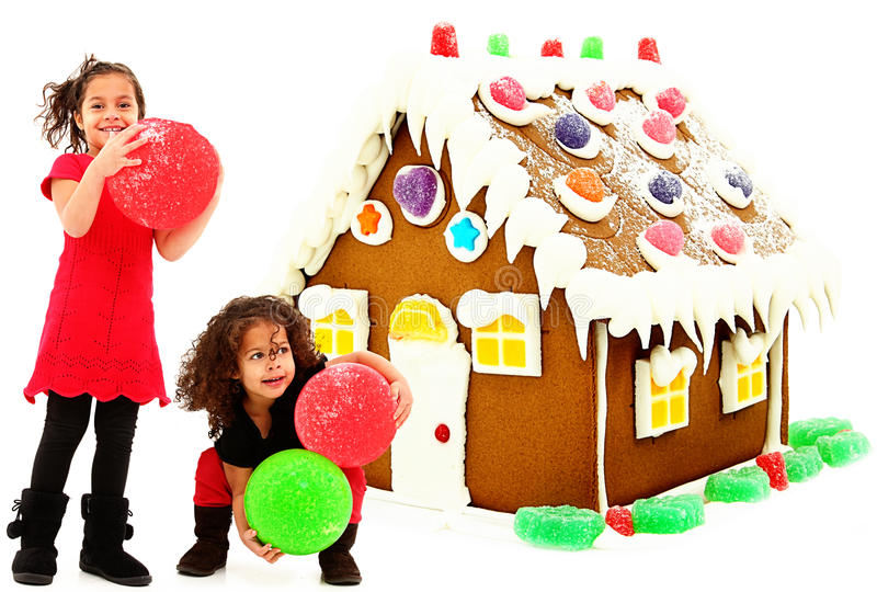 Hispanic African Children Buiding Gingerbread Hous royalty free stock images