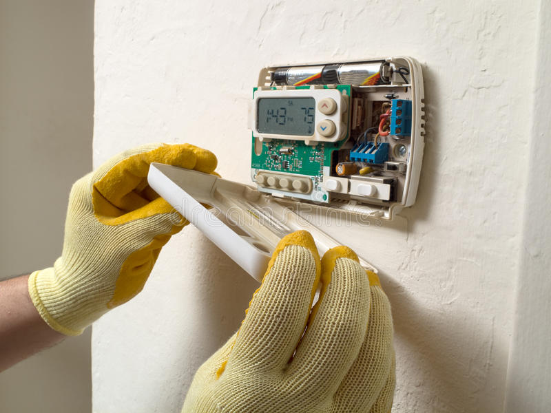Download Fixing The Thermostat Royalty Free Stock Photo - Image: 29972995