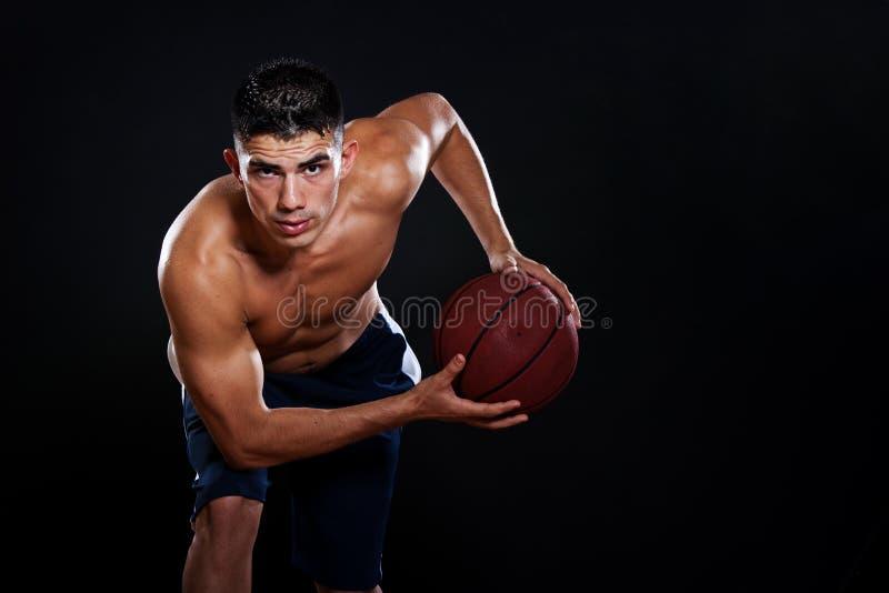 Hispanic basketball player. A portrait of a hispanic basketball player royalty free stock image