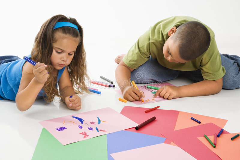 Hispanic boy and girl coloring. royalty free stock photography