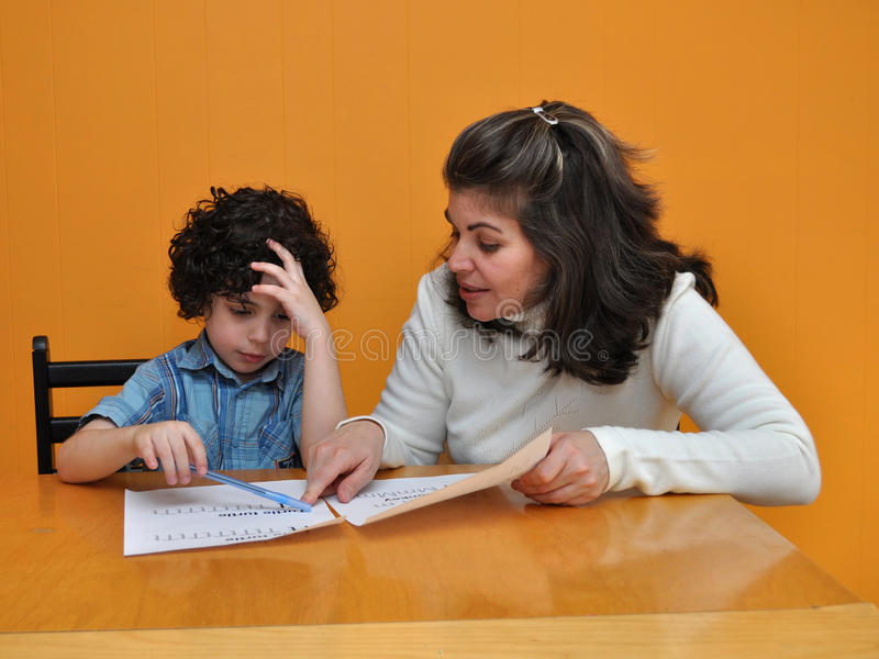 Hispanic Boy Learning to Write stock images
