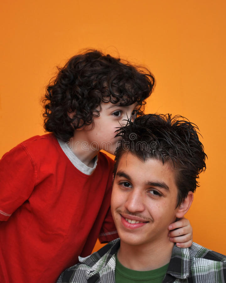 Little Child Kissing His Brother royalty free stock photo