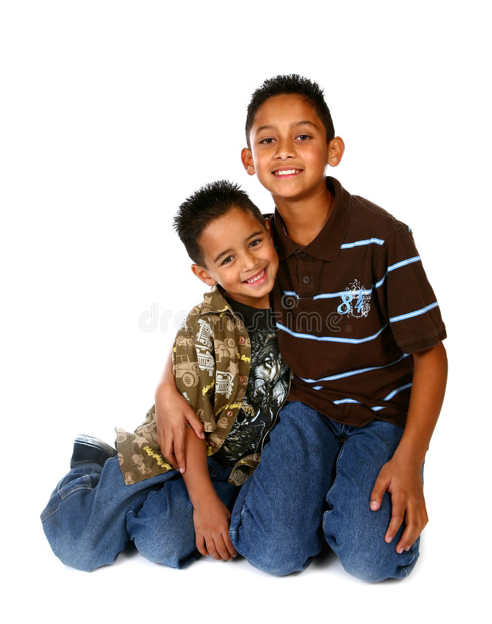 Hispanic Brothers Smiling and Hugging. On White Background royalty free stock photo