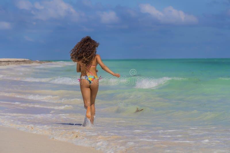 Hispanic Brunette Model Running At The Beach stock image