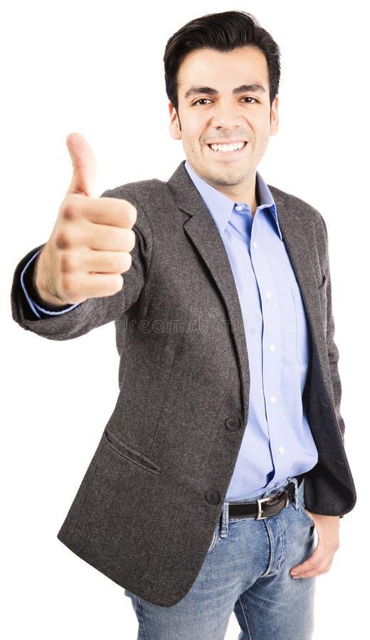 Hispanic business man giving thumbs up. Hispanic business man isolated on white background royalty free stock photo