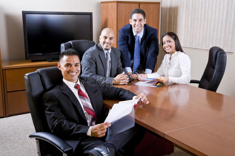 Hispanic business people meeting in boardroom royalty free stock photography