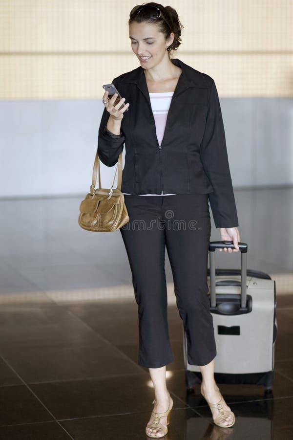 Hispanic businesswoman at airport stock photo