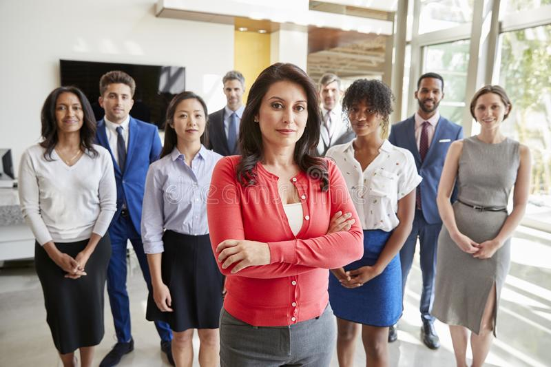 Hispanic businesswoman and her business team, group portrait stock photo