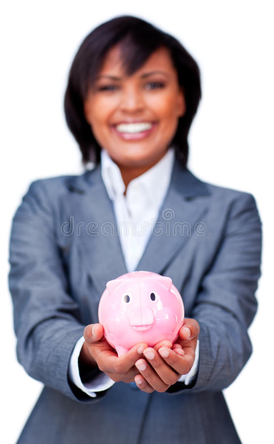 Hispanic Businesswoman holding a piggy-bank. Hispanic Businesswoman holding a piggy bank against a white background stock images